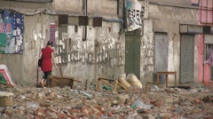 China, garbage dump, destruction, old quarter, suburbs, girl in red dress Stock Footage