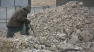 A Chinese worker drills concrete at construction site in China Stock Footage