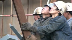 Chinese workers holding metal, industry, China, economy, iconic - stock footage