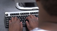 Stock Video Footage of Man typing over the shoulder view