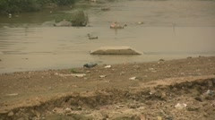 Zoom out of polluted and dry river in China Stock Footage