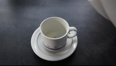 Teacup being filled with boiling water. - stock footage