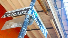 Street sign at the corner of Bourbon and Orleans - stock footage