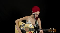 Woman plays guitar musician gipsy style Stock Footage