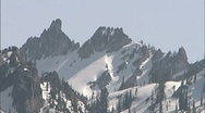 Stock Video Footage of Snowy Sawtooth Mountain Peaks