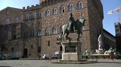 Italy, Tuscany, Statue of Cosimo I and Palazzo Vecchio Stock Footage