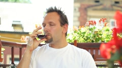 Handsome man drinking wine, outdoors Stock Footage
