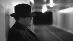 Mobster waiting in tunnel Stock Footage