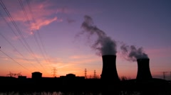 Beautiful time lapse of sunset behind a nuclear power plant. Stock Footage