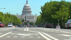 Bicycles pedal down Pennsylvania Ave. towards the U.S. Capitol building in Stock Footage