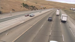 Highway traffic driving away Stock Footage