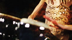 Female percussion drummer performing with bongos Stock Footage