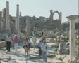 Crowd of people walking through ancient ruins Footage