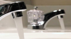 Double faucet sinks in bathroom (water on) V.01 Stock Footage