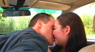 Stock Video Footage of Young Couple Making Out In Car- 2