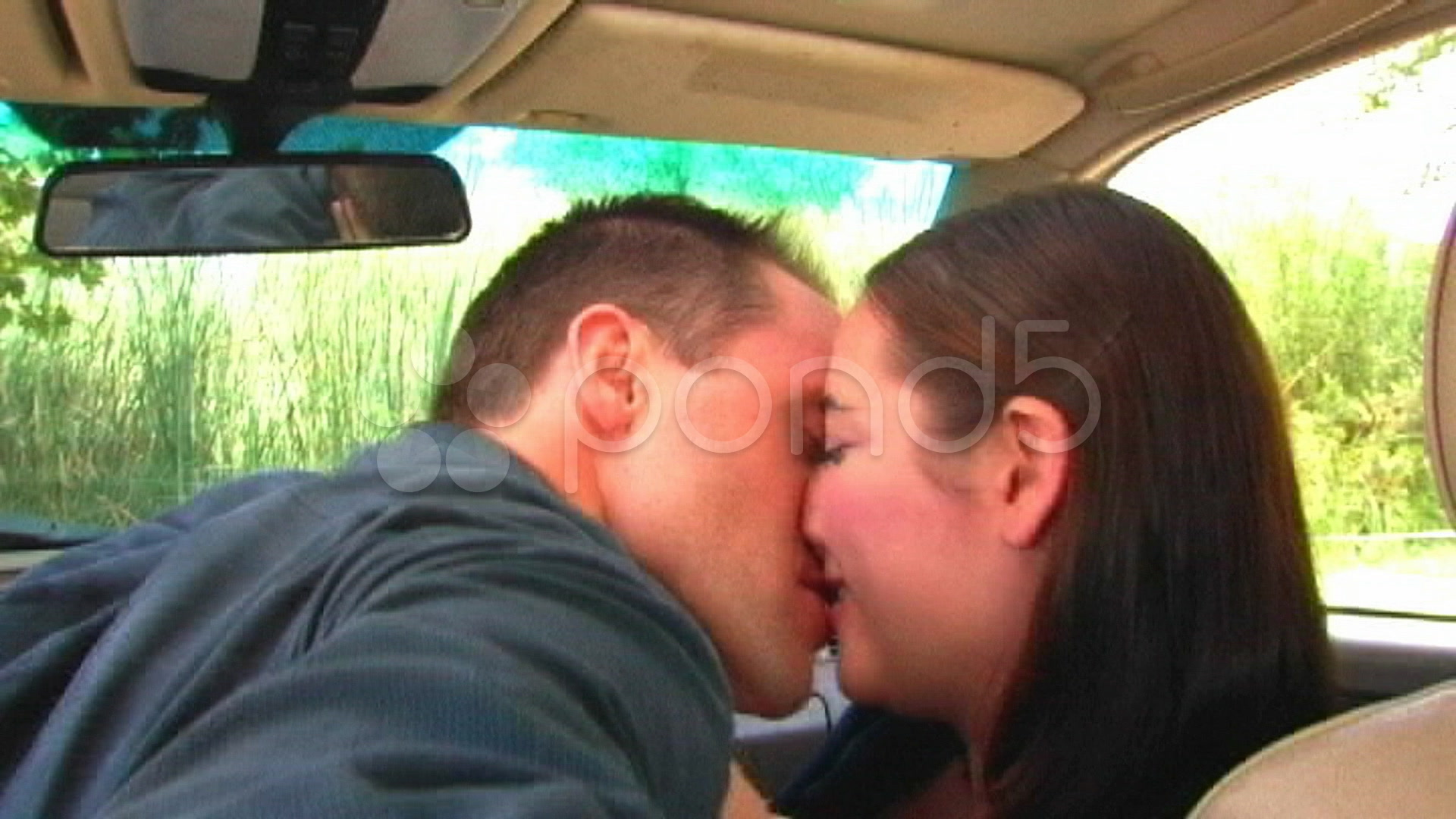 young couple making out in car 2 videos 8517097 hd stock footage. Black Bedroom Furniture Sets. Home Design Ideas