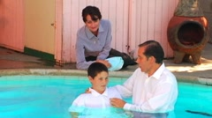 Baptism In Swimming Pool Stock Footage