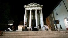 Band and people in front of Augustus temple Stock Footage