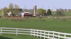 An amish farmer uses horses to plow his fields. Stock Footage