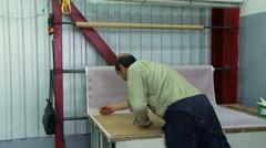 Man draws a cutting line Stock Footage
