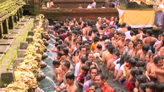 Spiritual bath in sacred pool with holy spring and fountains Stock Footage