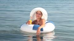 Floating on innertube Stock Footage