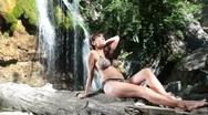 Stock Video Footage of woman in bikini near a waterfall