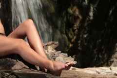 Female feet by the waterfall Stock Footage