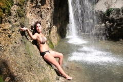 Woman under the waterfall Stock Footage