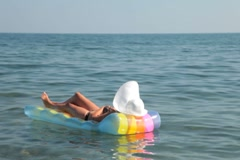 Woman relaxing on raft Stock Footage
