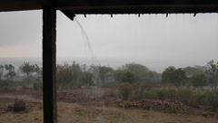 Rain Pouring Off a Roof in Africa Stock Footage