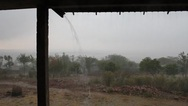 Stock Video Footage of Rain Pouring Off a Roof in Africa