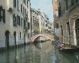 Venice canal trip goes under a pedestrian bridge SD Footage