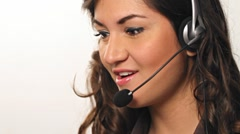 Pretty hispanic Customer service worker talking into headset Stock Footage