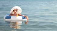 Woman on raft Stock Footage