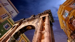 Night clouds and Roman arch Stock Footage