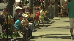 People enjoying a sunny day in the European town of Trenčín, Slovakia Stock Footage