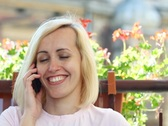 Attractive woman talking on mobile phone and drinking wine, outdoors NTSC Stock Footage