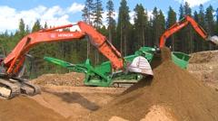 Construction, conveyor belt and dirt, #6 backhoes, wide shot Stock Footage