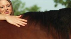 Pretty country girl petting her horse Stock Footage