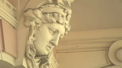 Female face architectural sculpture in European hotel Stock Footage