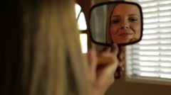 pretty girl putting on makeup - stock footage