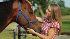 Pretty Girl Gets Horse Kisses Stock Footage
