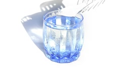Adding ice in to water; No splash Stock Footage