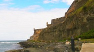 Stock Video Footage of Puerto Rico - El Morro Oceanfront Sidewalk and Cat Haven v1