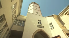 View of clock tower in the European town of Trenčín, Slovakia. Stock Footage