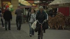 Pedestrians and cyclists passing through European town of Trenčín, Slovakia Stock Footage