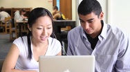 Stock Video Footage of Asian Female and African American Male Students in the Library