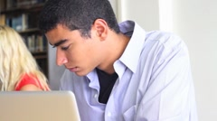 African American Male Student Studying in the Library Stock Footage