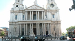 St Pauls Cathedral London with Black Cabs and a Red Bus 50i Stock Footage